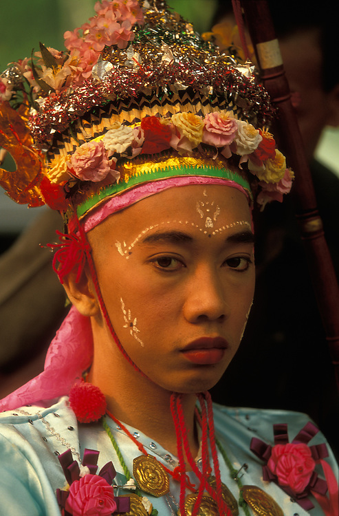 A young man, about to become a monk, during a procession at Poy Sang Long, the yearly ordination of novice monks, Mae Hong Son, Thailand.