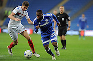 Cardiff City's Junior Hoilett (r) takes on Wigan's Reece Burke. EFL Skybet championship match, Cardiff city v Wigan Athletic at the Cardiff city stadium in Cardiff, South Wales on Saturday 29th October 2016.<br /> pic by Carl Robertson, Andrew Orchard sports photography.