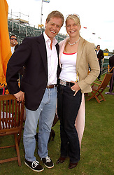 PETER & SOPHIA THOMPSON at the Veuve Clicquot sponsored Gold Cup or the British Open Polo Championship won by The  Azzura polo team who beat The Dubai polo team 17-9 at Cowdray Park, West Sussex on 18th July 2004.