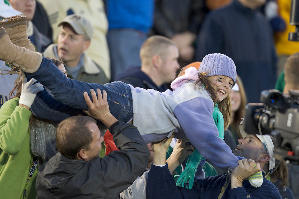 Notre Dame fan celebrates touchdown with pushups during fourth quarter of NCAA football game between Notre Dame and Navy.  The Notre Dame Fighting Irish defeated the Navy Midshipmen 56-14 in game at Notre Dame Stadium in South Bend, Indiana.