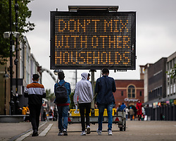 """© Licensed to London News Pictures . 16/09/2020. Bolton , UK . A sign advising visitors in Bolton Town Centre """" Don't Mix with Other Households """" in Victoria Square . The number of recorded cases of Coronavirus has gone over 200 in a single day , in Bolton . Photo credit : Joel Goodman/LNP"""