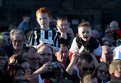 St Mirren fans cheering during the winner's parade through Paisley.