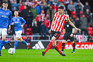 Tom Flanagan of Sunderland (12) passes the ball during the EFL Sky Bet League 1 first leg Play Off match between Sunderland and Portsmouth at the Stadium Of Light, Sunderland, England on 11 May 2019.
