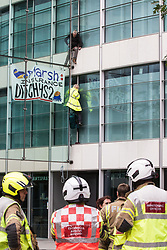 London, UK. 2nd September, 2021. London Fire Brigade firefighters observe two climate activists from HS2 Rebellion who scaled the Tower Place West building in the City of London in protest against the involvement of insurance company Marsh in the HS2 high-speed rail project. Marsh insure subcontractors working on HS2.