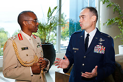 U.S. Air Force Col. David Delmonaco, System of Cooperation Among the American Air Forces secretary general, speaks with Jamaica Chief of Defence Staff Maj. Gen. Rocky Meade at CONJEFAMER in Panama City, Panama, June 19, 2018.  At this year's conference, Jamaica became the 21st voting member nation of SICOFAA, further cementing the organization's presence in the Caribbean.  (U.S. Air Force Photo by Capt. Stephanie Schonberger)