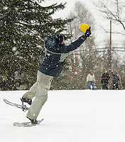 Jason Baldini stretches for the frisbee thrown by his teammate Ryan McGarghan during the Snowshoe Disc Golf Tourney Saturday afternoon at Tavern 27 and Mystic Meadows.  (Karen Bobotas/for the Laconia Daily Sun)