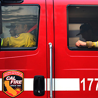 A weary Cal Fire crew heads through Boulder Creek, California to their next assignment on August 24, 2020 as more than 2,000 firefighters battle the CZU August Lightning Complex.
