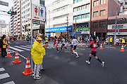 Volunteers hold a sign informing runners where the next toilet facilities are during the 10th Tokyo Marathon took place on a fine spring day in Tokyo Japan. Sunday February 28th 2016. Thirty-six thousand runners took part with Ethiopian,  Feyisa Lilesa winning the  men's competition and  Kenyan, Helah Kiprop victorious in the women's race.