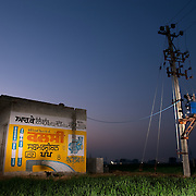 An advertising for deep tubewell water pumps painted on a shed on the Chandigarh-Ludhiana highway. Farmers in punjab are facing problems of depleting levels of underground water that in some places is as deep as 700ft. They complain that the state government does not supply enough electricity to use the pumps. They only receive 3-5hr of electricity per day and have to use diesel generators to pump the water for their fields.