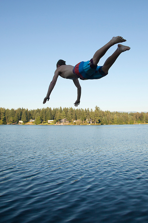United States, Washington, Lake Sawyer, teenage boy diving into lake