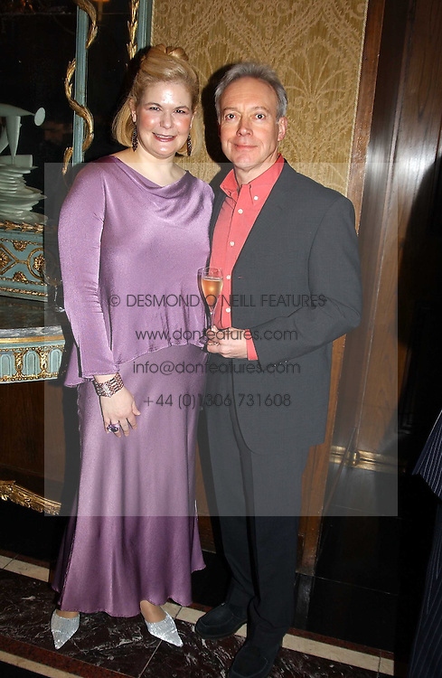 MRS JEREMY WAYNE and actor NIKOLAS GRACE at the Tatler Restaurant Awards in association with Champagne Louis Roederer held at the Four Seasons Hotel, Hamilton Place, London W1 on 10th January 2005.<br />