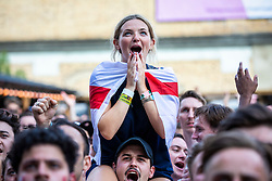 **2018 Pictures of the year by London News Pictures**<br /> © Licensed to London News Pictures. 07/07/2018. London, UK. England fans react as they watch England v Sweden in the World Cup Quarter Final as it is shown on the big screen at Flat Iron Square in London. Photo credit: Rob Pinney/LNP