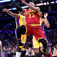 15 January 2015: Cleveland Cavaliers forward LeBron James (23) goes for the reverse layup past Los Angeles Lakers center Jordan Hill (27) and Los Angeles Lakers forward Wesley Johnson (11) during the Cleveland Cavaliers 109-102 victory over the Los Angeles Lakers, at the Staples Center, Los Angeles, California, USA.