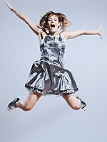 beautiful young caucasian woman girl evening dress jumping screaming happy on studio isolated plain background