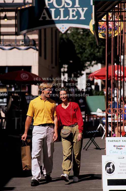 Image of a couple walking in Post Alley, Seattle, Washington, Pacific Northwest, model released by Randy Wells