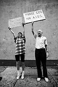 An AIDS protester is countered by a counter protester outside the Cobb Co. courthouse in Marietta, GA