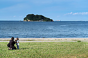 mother with child at Umikaze park, Yokosuka with Tokyo Bay and Sarushima Island