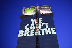 "© Licensed to London News Pictures. 05/07/2020. London, UK.  A light projection reading 'WE CAN'T BREATHE' is cast onto the shell of Grenfell Tower in West London on the eve of the second phase of the Grenfell Tower Fire Inquiry. The slogan echoes the words spoken on the night recorded on calls to emergency services and loved ones begging for help that never came.  Abbas Dadou, Chairman of Lancaster West Estate Residents Association comprising 800 homes and 2000 residents said ""We stand in solidarity with the families who lost their loved ones in their fight for justice. They are us and we are with them. They are part of our community and their fight for justice is our fight."" El  Alami Hamdan who lost his daughter and his grandchildren in the fire said ""how long must we wait for justice? It has been three years and still nothing. They promise everything and they do nothing""'  <br /> <br /> A press conference will be held this morning ahead of the Inquiry resuming, where a full statement will be released at 10am ""Family members of those who perished in the fire that took the lives of 72 people on June 14 in 2017 attended the projection of 'We can't breathe' These words echo what we heard on the 999 calls of our loved ones, or the last breath taken by our brothers and sisters, mothers and fathers and our children that night as they begged for help. We have had to listen to these calls as part of the Inquiry reliving their pain and suffering and the failures which cost the lives of our loved ones that night.  We are no longer going to keep silent. We demand justice. We want prosecutions. Our loved ones are not here to speak for themselves and we must speak for them"".  Photo credit: Guilhem Baker/LNP"