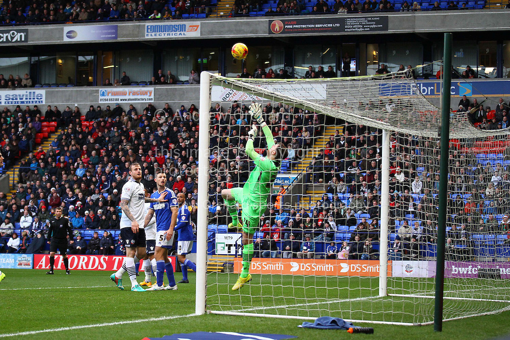 Bolton Wanderers Goalkeeper Andy Lonergan keeps his eye on the ball and saves from Daryl Murphy of Ipswich (not in pic). . Skybet football league championship match, Bolton Wanderers v Ipswich Town at the Macron stadium in Bolton, Lancs on Saturday 13th December 2014.<br /> pic by Chris Stading, Andrew Orchard sports photography.