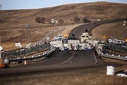 November 25, 2016 - Cannon Ball, North Dakota, U.S - A fortified barricade on Highway 1806 blocks access to the construction site of the Dakota Access Pipeline near the Oceti Sakowin Camp at the Standing Rock Indian Reservation in Cannon Ball, North Dakota. (Credit Image: © Joel Angel Ju‡Rez via ZUMA Wire)