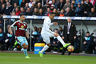 Martin Olsson of Swansea city ® in action. Premier league match, Swansea city v Burnley at the Liberty Stadium in Swansea, South Wales on Saturday 4th March 2017.<br /> pic by Andrew Orchard, Andrew Orchard sports photography.