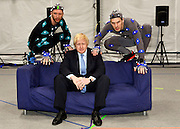 """© Licensed to London News Pictures. 04/04/2013. London, UK Boris Johnson the Mayor of London, visits Ealing studios today, 4th April 2013, where he announced his plans to boost London's TV, Animation and Film industries, capitalising on the new tax relief brought in by the Chancellor (from 1st April 2013) to bring major jobs and investment to the capital. He toured the Studios and spent time in the """"Imaginarium"""", where he had a go at mastering 'performance capture'. . Photo credit : Stephen Simpson/LNP"""