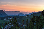 Sunset over the Cascade Range from Mazama Ridge. The Paradise Inn, Henry M. Jackson Visitor Center and Paradise Valley Road are in the foreground - Mount Rainier National Park, Washington State, USA.