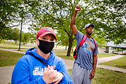 05 AUGUST 2020 - DES MOINES, IOWA: A member of Black Lives Matter puts his fist in the air during a Black Lives Matter celebration of the restoration of felons' voting rights in Iowa. Members of Black Lives Matter had a press conference in central Des Moines Wednesday to comment on the executive order issued by Iowa Governor Kim Reynolds earlier Wednesday that restored voting rights felons who have completed their sentence and probation or parole. BLM has been protesting in Des Moines and meeting with the governor since early June in their effort to restore felons' voting rights. Until today, Iowa was the only state in the US that permanently stripped felons of their voting rights.    PHOTO BY JACK KURTZ