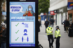 © Licensed to London News Pictures. 25/05/2021. London, UK. A billboard in the Hight Street in Hounslow, west London reminds shoppers of Covid safety measures. The government have advised against travel in eight areas in England, including the London borough of Housnlow, because of the rising number of Covid-19 infections due to the Indian variant of the disease. Photo credit: Peter Macdiarmid/LNP
