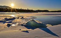 Frozen blocks of ice are illuminated by the winter sun