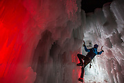 Climbing at night with some flashes with gels to enlight the ice.