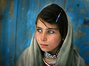 Ajar (sister). One family..Many Wakhis are blue eyed. Some say descendant of Alexander the Great..Winter expedition through the Wakhan Corridor and into the Afghan Pamir mountains, to document the life of the Afghan Kyrgyz tribe. January/February 2008. Afghanistan