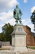 """A bronze statue of Captain John Smith (1580-1631) stands next to the 1639 Jamestown Church at Historic Jamestowne, on Jamestown Island in Virginia, USA. He was an English soldier, explorer, author, and Admiral of New England who led exploration along rivers of Virginia and Chesapeake Bay. He helped establish the first permanent English settlement in North America, and was governor of the Virginia Colony 1608-1609. He was briefly associated with the Virginia Indian girl Pocahontas during an altercation with the Powhatan Confederacy and her father, Chief Powhatan. John Smith named New England, and his books and maps encouraged more English people to colonize the New World: """"Here every man may be master and owner of his owne labour and land...If he have nothing but his hands, he may...by industrie quickly grow rich."""""""