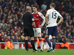 Referee Mike Dean speaks to Arsenal's Granit Xhaka during the Premier League match at the Emirates Stadium, London.