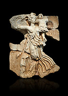 Roman Sebasteion relief  sculpture of the goddess Victory, Aphrodisias Museum, Aphrodisias, Turkey.   Against a black background.<br /> <br /> A winged goddess Victory( Nike) flies past carrying a military trophy. She wears a long light dress and has one breast and one leg exposed. Her clothing is set in motion by her swift flight. .<br /> <br /> If you prefer to buy from our ALAMY STOCK LIBRARY page at https://www.alamy.com/portfolio/paul-williams-funkystock/greco-roman-sculptures.html . Type -    Aphrodisias     - into LOWER SEARCH WITHIN GALLERY box - Refine search by adding a subject, place, background colour, museum etc.<br /> <br /> Visit our ROMAN WORLD PHOTO COLLECTIONS for more photos to download or buy as wall art prints https://funkystock.photoshelter.com/gallery-collection/The-Romans-Art-Artefacts-Antiquities-Historic-Sites-Pictures-Images/C0000r2uLJJo9_s0