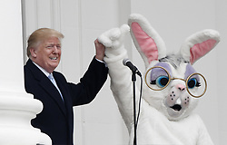 President Donald Trump holds hands with the Easter bunny during the 140th Easter Egg Roll on the South Lawn of the White House in Washington, DC on Monday, April 2, 2018. Photo by Olivier Douliery/Abaca Press
