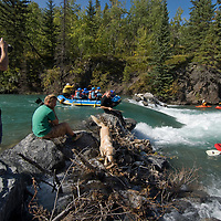 A photography class shoots kayakers and rafters on the Kananaskis River in the Canadian Rockies near Calgary, Alberta.