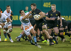 January 11, 2019 - Sugar Land, TX, U.S. - SUGAR LAND, TX - JANUARY 11: Austin Elite scrumhalf Mickael Romera (9) reaches out to tackle Houston SaberCats 8-man Alex Elkins (8) during the pre-season exhibition rugby match between the Austin Elite and Houston SaberCats on January 11, 2019 at Constellation Field in Sugar Land, Texas.  (Photo by Leslie Plaza Johnson/Icon Sportswire) (Credit Image: © Leslie Plaza Johnson/Icon SMI via ZUMA Press)