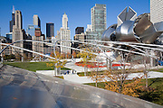 View of the trellis structure and the Frank Gehry-designed Jay Pritzker Pavilion in Millennium Park, Chicago, Il. USA .