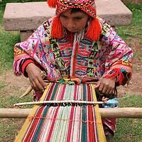 Americas, South America, Peru, Cusco. Young boy weaver at Awana Kancha.