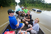 Off-duty Lafourche Parish sheriff's deputies help Kimberly and Anthony Burkett, along with their son and their dogs, get out of their second-story window in their flooded neighborhood in Baton Rouge on Sunday, August 14, 2016. (Photo by Chris Granger, Nola.com | The Times-Picayune)