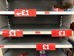 © Licensed to London News Pictures. 13/03/2020. Leeds UK. SAINSBURY'S LEEDS. Empty Chocolate Buttons shelves at Sainsbury's in the Colton area of Leeds this morning as people continue to panic buy in fear of quarantine measures and shortages as the current Coronavirus ( COVID-19 ) spread starts to impact more people. Photo credit: Andrew McCaren/LNP