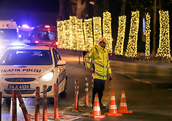 Terror in der T¸rkei: Zwei Bombenanschl‰ge nach dem Fussballspiel Besiktas gegen Bursaspor nahe der Vodafone-Arena in Istanbul fordern Todesopfer unter den Polizeikr‰ften / 101216<br /> <br /> ***Police officers block as ambulances rush to a soccer stadium in Istanbul, Saturday night, December 10, 2016.  Nearly 38 people, mostly police officers lost their lives after twin bomb attacks outside the stadium in Istanbul Saturday night following a soccer game.***
