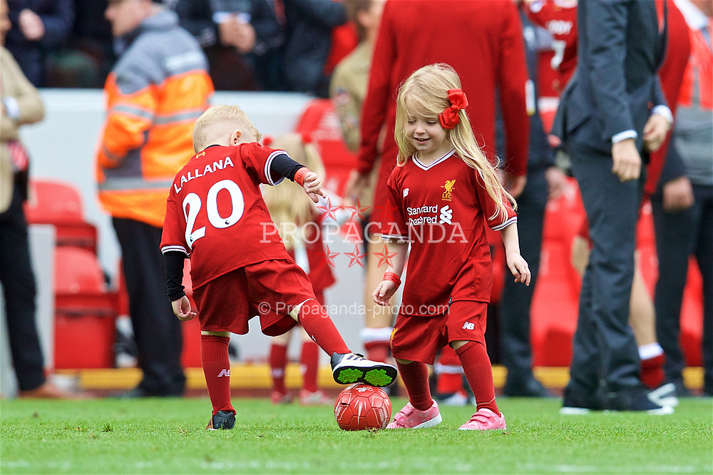LIVERPOOL, ENGLAND - Sunday, May 21, 2017: The children of Liverpool players run on the pitch after the 3-0 victory over Middlesbrough during the FA Premier League match at Anfield. Adam Lallana. (Pic by David Rawcliffe/Propaganda)