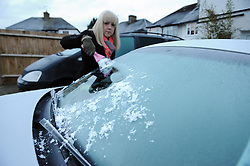 © Licensed to London News Pictures. 19/01/2015<br /> Cleaning ice off the car.<br /> A very cold morning St Pauls Cray,Orpington,Kent. today (19.01.2015)<br /> Weather warning has been issued across most of the uk as temperatures dropped overnight to -11c in parts.<br /> <br /> (Byline:Grant Falvey/LNP)