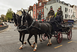 © Licensed to London News Pictures. 10/04/2021. Windsor, UK. A horse and carriage are driven past Windsor Castle in Berkshire, the morning after the death of The Duke of Edinburgh. Yesterday (Fri) The British Royal Family announced the death of Prince Philip, The Duke of Edinburgh, at the age of 99 today. Photo credit: Stuart Brock/LNP