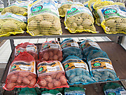 Bags of seed potatoes on sale Ladybird Nurseries garden centre, Gromford, Suffolk, England, UK