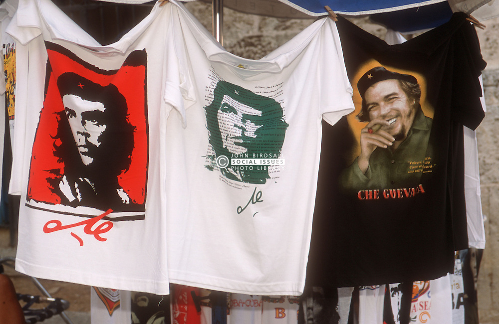 Printed tshirts showing image of Che Guevara hanging from market stall in Havana; Cuba,