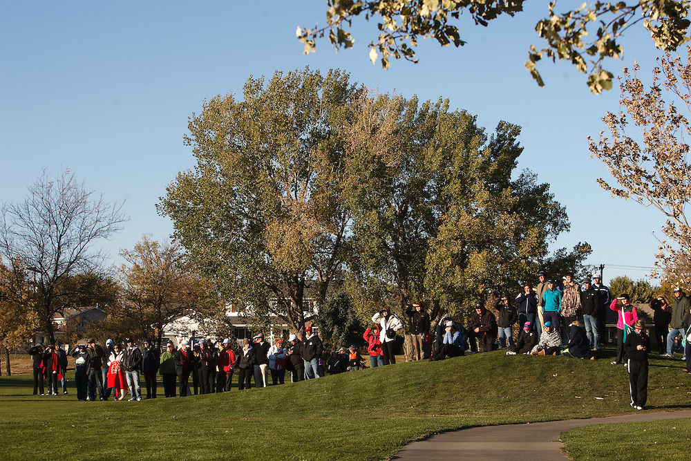 Spectators gather to watch as Maaika Mestl of Ogallala and McKenna Kime of Grand Island Central Catholic putt during a playoff to decide the individual winner of the Class C State Championship Tuesday at Quail Run Golf Course in Columbus. Kime, a senior, would win by scoring a par. (Independent/Matt Dixon)