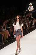 Loose shorts in tones of gray and a short sleeve white embroidered blouse with Peter Pan collar.